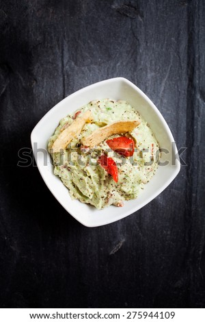 Homemade guacamole with tortilla chips - stock photo