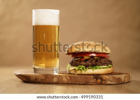 homemade hamburger with beer on background