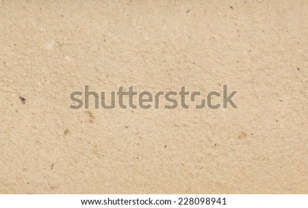 Homemade hand crafted textured paper with inclusions of colored spots on a beige grey background. Useful for scrapbooking and greeting cards - stock photo