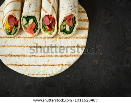 Homemade healthy wraps for lunch or picnic with place for text or menu