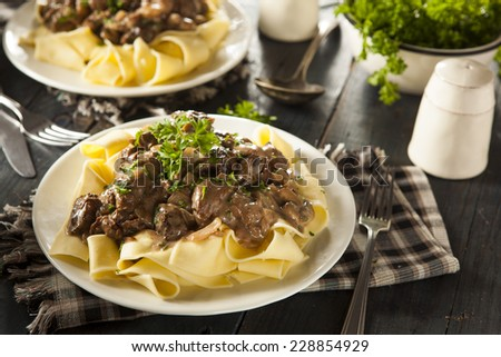 Homemade Hearty Beef Stroganoff with Mushrooms and Noodles - stock photo