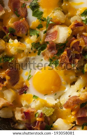 Homemade Hearty Breakfast Skillet with Eggs Potatoes and Bacon - stock photo