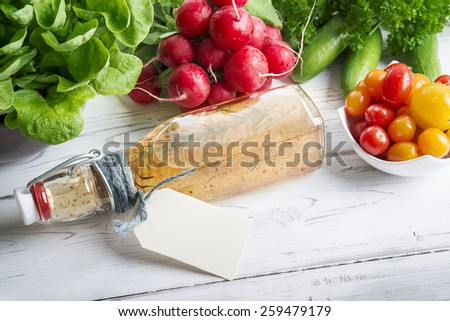 Homemade herb dressing and fresh ingredients - stock photo