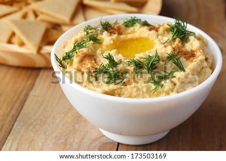 Homemade hummus with healthy chips - stock photo