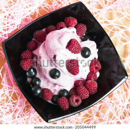 Homemade ice cream with black currant and raspberry - stock photo