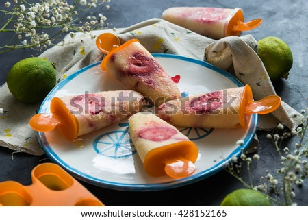 Homemade ice cream with pineapple,strawberry and lime - stock photo