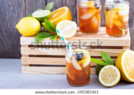 Homemade iced tea in mason jars with straws - stock photo