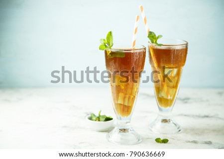 Homemade iced tea with mint and lemon or Arnold Palmer drink