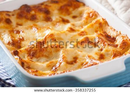 homemade italian lasagna in baking dish - stock photo