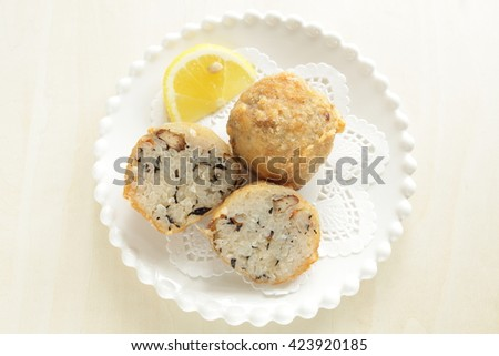 Homemade Japanese fusion food, deep fried rice ball - stock photo