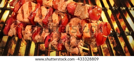 Homemade Kebabs From Different Meat Mixed With Pepper And Tomato On The Hot Charcoal BBQ Grill - stock photo