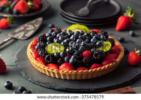 Homemade Key Lime Fruit Tart with Berries - stock photo