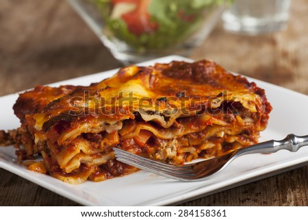 homemade lasagna on rustic wood  - stock photo