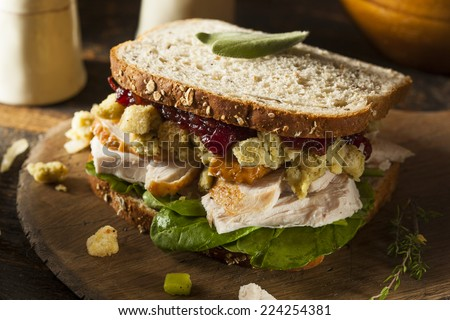 Homemade Leftover Thanksgiving Dinner Turkey Sandwich with Cranberries and Stuffing - stock photo