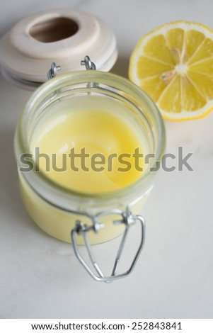 Homemade lemon curd or cream in a jar, selective focus - stock photo