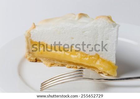 Homemade lemon meringue pie, a classic of European dessert cuisine - stock photo