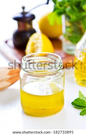 Homemade Lemon vinaigrette dressing by fresh ingredients - stock photo