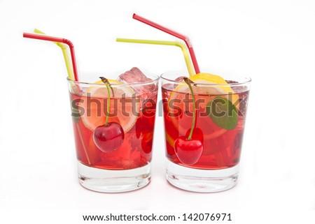 Homemade  lemonade / iced tea with fresh cherries, lemons and mint on white - stock photo