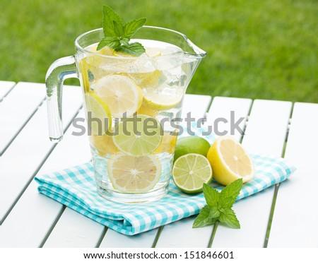 Homemade lemonade with fresh citruses - stock photo