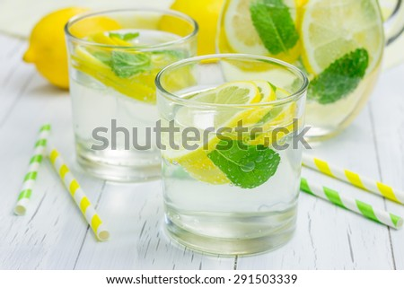 Homemade lemonade with fresh lemon and mint  - stock photo