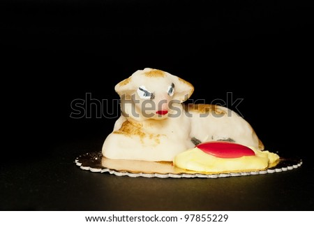 Homemade marzipan  Sheep cake, Easter cake typical in Sicily, isolated on black - stock photo