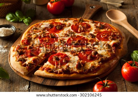 Homemade Meat Loves Pizza with Pepperoni Sausage and Bacon - stock photo