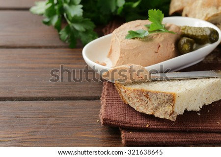 homemade meat pate with pickles and white bread