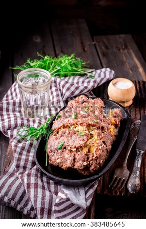 Homemade meat roll on iron pan. Style rustic. Selective focus. - stock photo