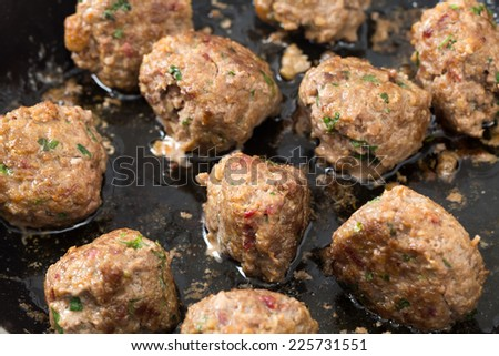 Homemade meatballs in a frying pan after cooking - stock photo