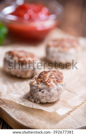 Homemade Meatballs (selective focus) on dark wooden background