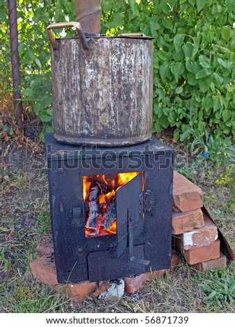 Homemade metal outdoor stove for summer time - stock photo