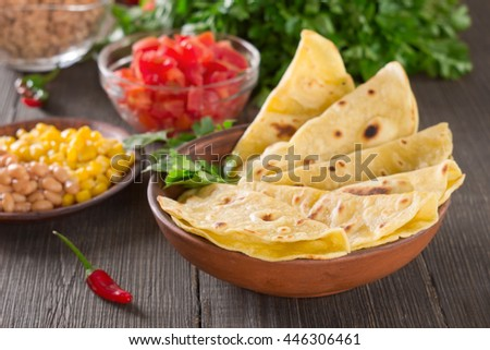 Homemade mexican tortilla with ingredients. - stock photo