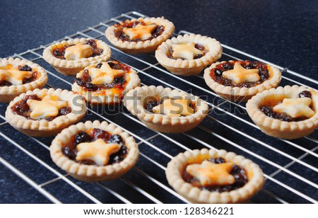 Homemade Mince pies on a cooling rack - stock photo