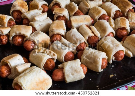 Homemade mini hot dogs (sausage dough) on the tray - stock photo