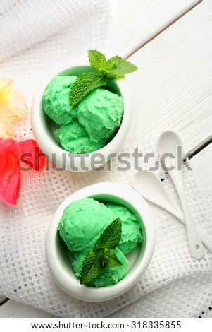 Homemade mint ice-cream on light wooden background