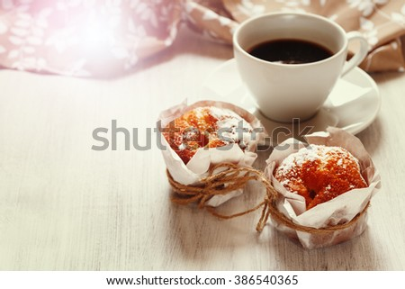 Homemade Muffins with Cup of Black Coffee for Morning Breakfast Close-up. Copy Space. Selective Focus. - stock photo