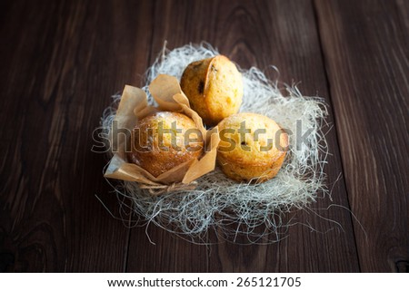 Homemade muffins with decoration on old wood table