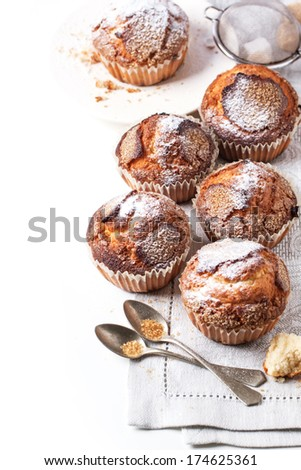 Homemade muffins with powdered sugar over white. See series - stock photo