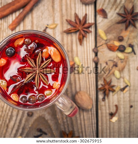 homemade mulled wine with spices on a wooden table. toned image - stock photo