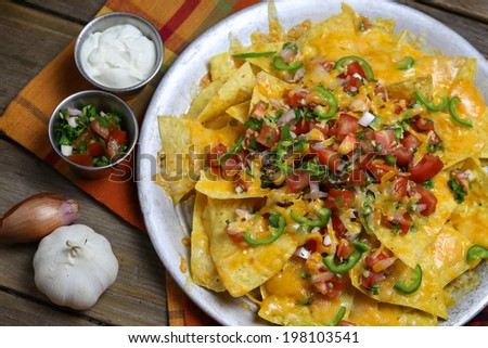 Homemade Nachos with Cheese and Vegetables  - stock photo