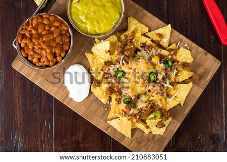 Homemade Nachos with Cheese Beans and Beef - stock photo