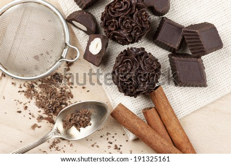 Homemade natural chocolate candies with ingredients on wood. - stock photo