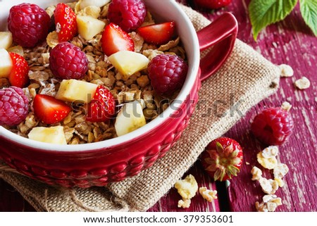Homemade oatmeal cereal with fresh raspberries, strawberries and banana in a ceramic bowl. Morning breakfast. Bio healthy food. Rustic style. Selective focus - stock photo