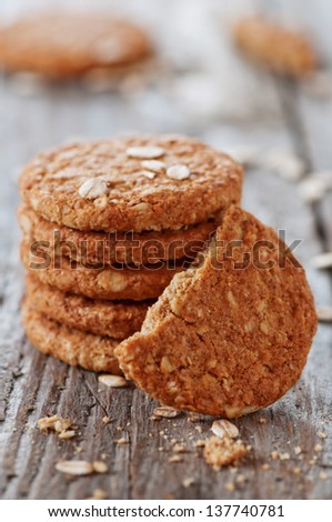 Homemade oatmeal cookie on the wooden table, selective focus - stock photo