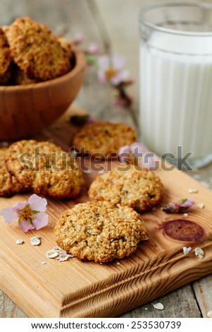 Homemade oatmeal cookies and a glass of milk
