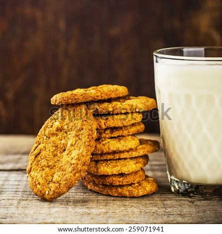 Homemade oatmeal cookies and a glass of milk - stock photo