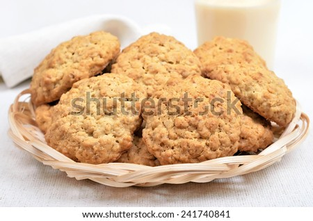 Homemade oatmeal cookies and milkshake on white background, close up view - stock photo