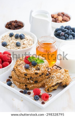 homemade oatmeal cookies for a healthy breakfast, vertical, closeup - stock photo
