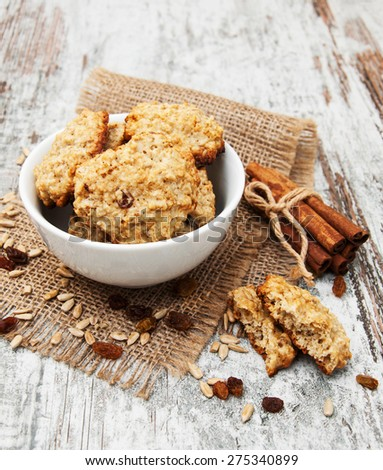 Homemade Oatmeal cookies on a old wooden table - stock photo