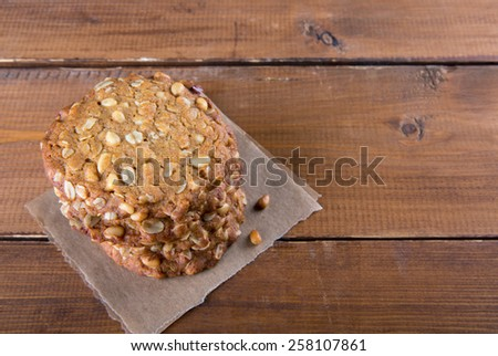 Homemade oatmeal cookies with pine nuts on wooden background. Top view. - stock photo